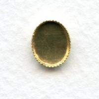Serrated Edge Settings 10x8mm Raw Brass (12)